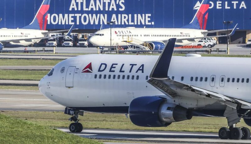 Delta to levy $200/mth health care surcharge on unvaccinated employees